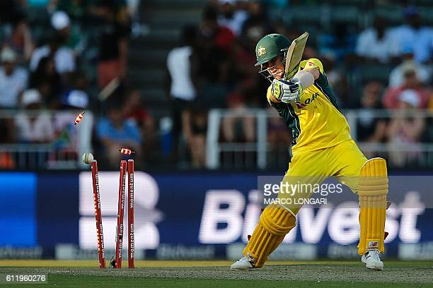 Stops are seen flying as Australia's batsman Adam Zampa is eliminated by South African bowler Andile Phehlukwayo during the second One Day...