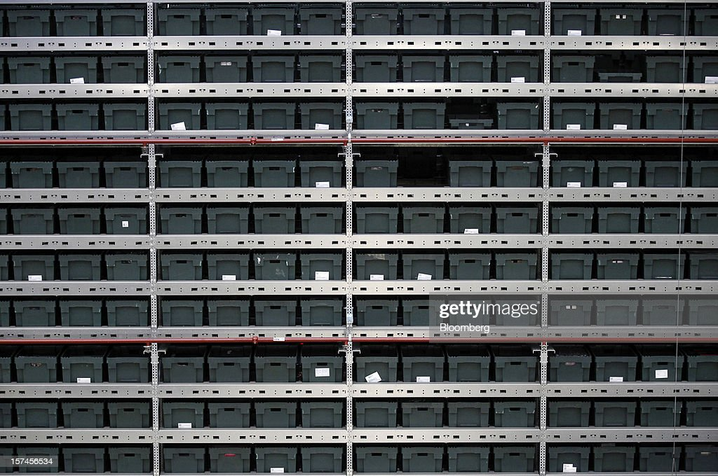 Storage crates sit ready for use at John Lewis Plc's distribution centre in Milton Keynes, U.K., on Monday, Dec. 3, 2012. An index of U.K. retail sales rose to a five-month high in November, according to a monthly report from the Confederation of British Industry. Photographer: Simon Dawson/Bloomberg via Getty Images
