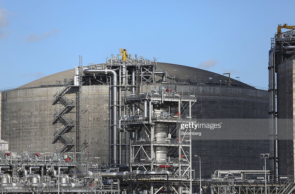 A storage tank is seen at the National Grid Plc's liquid natural gas (LNG) facility, following the opening of a joint venture with the EON AG, on the Isle of Grain , U.K., on Thursday, Oct. 4, 2012. The National Grid Plc and E.ON have worked together to link two plants with twin pipelines, allowing surplus heat from electricity generation at E.ON's power station to heat LNG and convert it back to gas. Photographer: Chris Ratcliffe/Bloomberg via Getty Images