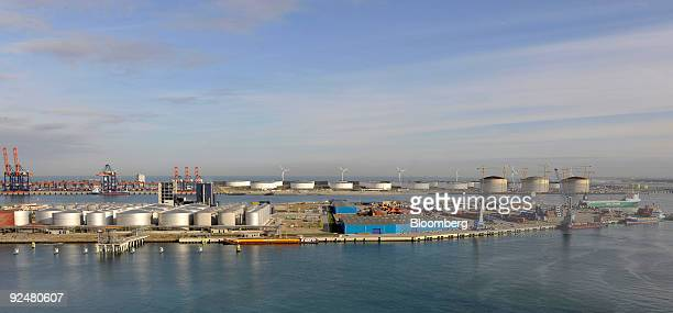 Storage tanks and wind turbines are seen at the port of Rotterdam in The Netherlands on Tuesday Oct 27 2009 The Port of RotterdamÕs throughput fell...