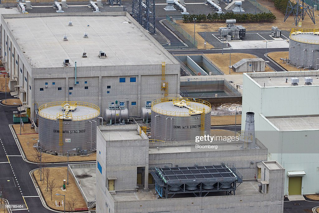 Storage tanks, center, stand at Korea Hydro & Nuclear Power Co.'s Shin-Kori nuclear power plant in Ulsan, South Korea, on Tuesday, Feb. 5, 2013. Korea Hydro, a unit of Korea Electric Power Corp. (Kepco), operates 23 reactors in the country. Photographer: SeongJoon Cho/Bloomberg via Getty Images