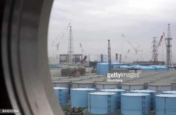 Storage tanks for contaminated water stand at Tokyo Electric Power Co's Fukushima Daiichi nuclear power plant in Okuma Fukushima Japan on Thursday...