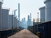 storage tanks in a row near the port of Rotterdam The Netherlands,In the back petrochemical plant