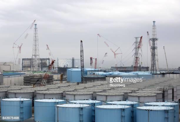 Storage tanks of contaminated water stand at Tokyo Electric Power Co's Fukushima Daiichi nuclear power plant in Okuma Fukushima Japan on Thursday Feb...