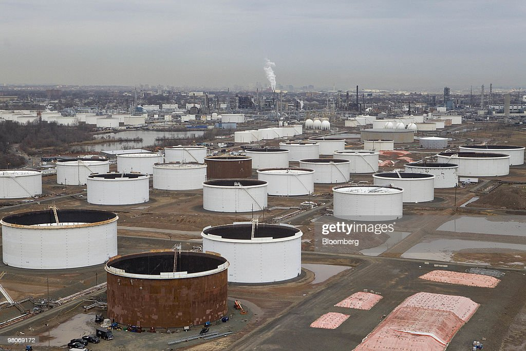 Storage tanks sit on the grounds of the ConocoPhilips Bayway refinery as viewed from an A-star 350 B-2 helicopter made by Eurocopter SA, one of six in the fleet of Liberty Helicopters Inc., as it flies over Linden, New Jersey, U.S., on Thursday, March 25, 2010. Liberty Helicopters Inc. is offering to fly weary commuters from New Jersey to Manhattan for about $200 a day, saving them 14 hours in traffic a week and signaling that Wall Street may have seen the worst of the recession. Photographer: Daniel Acker/Bloomberg via Getty Images