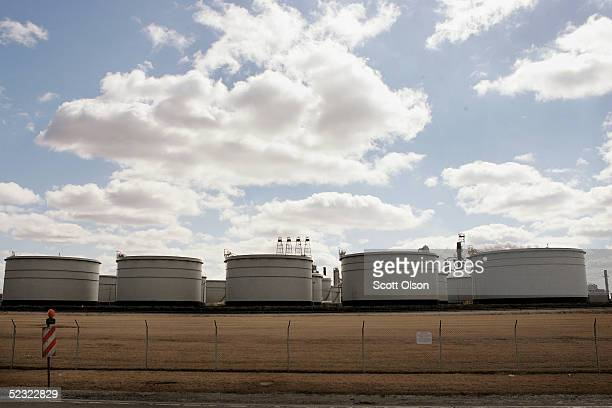 Storage tanks stand inside a fence surrounding an ExxonMobil oil refinery March 8 2005 in Joliet Illinois Gasoline prices nationwide have climbed in...