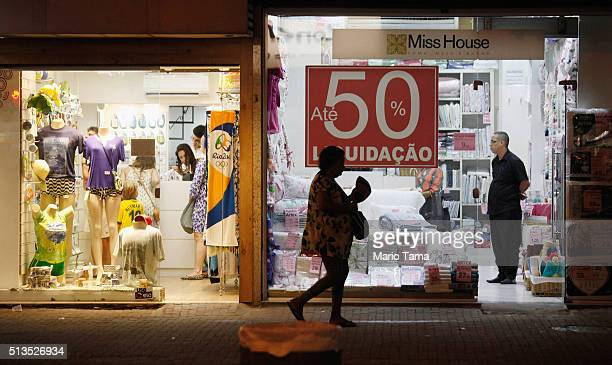 A store advertises 50 percent discounts on March 2 2016 in Rio de Janeiro Brazil The government announced today that Brazil's economy shrank 38...