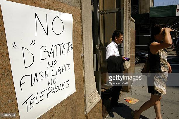 A store advertises no batteries flashlights or telephones August 15 2003 in New York City Power went out across the East Coast of the US and Canada...
