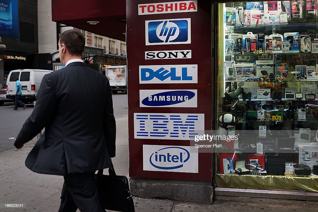 A store advertises the names of personal computer makers (PC's) in Times Square on April 11, 2013 in New York City. Shipments of PCs fell 14% worldwide last quarter, sending shares of personal computer chipmakers, manufacturers and software companies sharply lower. As more people around the world turn to smart phones and tablets, PC sales had their worst quarter in history.