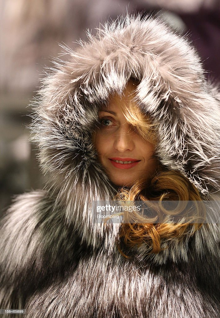 A store assistant models a sable fur coat and hood in this arranged photograph at the World of Fur and Leather store in Moscow, Russia, on Sunday, Dec. 16, 2012. Russia's government should introduce a tax on luxury consumption in first half of 2013, President Vladimir Putin said in state-of-the-nation address in Moscow. Photographer: Andrey Rudakov/Bloomberg via Getty Images