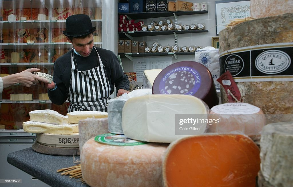 A store assistant prepares cheese for a customer in a cheese store on July 12, 2007 in London, England. Government advisors are considering a tax on high fat foods to tackle obesity. Foods targeted include dairy products such as fatty cheese, full fat milk and fresh butter. (Photo by Cate Gillon/Getty Images) Cate Gillon/Getty Images)