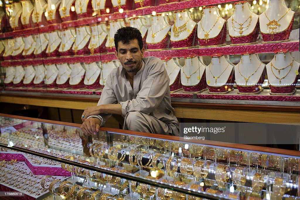 A store assistant sits surrounded by gold jewelry displayed for sale at a jewelry store inside Noor Shopping Center in Kabul, Afghanistan, Wednesday, Aug. 7, 2013. A smooth U.S. exit from Afghanistan will depend on Pakistans cooperation with the logistical pullout, as well as its backing for peace talks in neighboring Afghanistan and an end to any support for extremist proxies operating there. Photographer: Victor J. Blue/Bloomberg via Getty Images