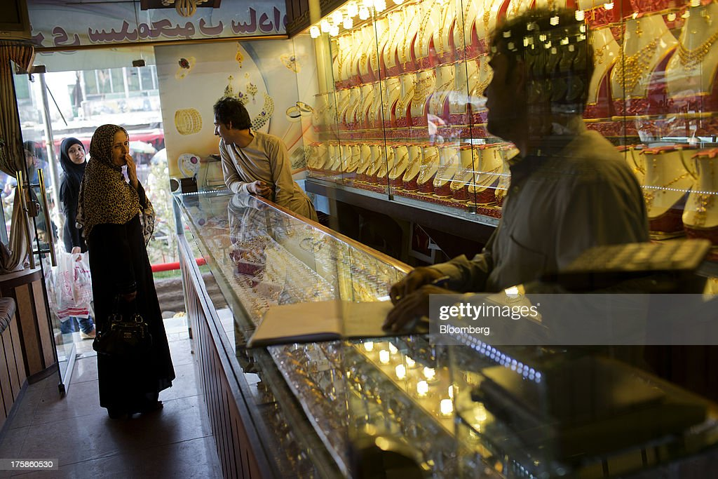 Store assistants talk with customers in a jewelry store inside Noor Shopping Center in Kabul, Afghanistan, Wednesday, Aug. 7, 2013. A smooth U.S. exit from Afghanistan will depend on Pakistans cooperation with the logistical pullout, as well as its backing for peace talks in neighboring Afghanistan and an end to any support for extremist proxies operating there. Photographer: Victor J. Blue/Bloomberg via Getty Images