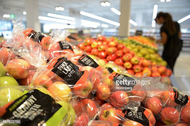 Store brand packages of Pink Lady apples are displayed for sale in the produce section of a Coles supermarket operated by Wesfarmers Ltd in Melbourne...