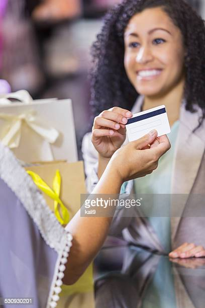 Store cashier taking credit card payment from customer