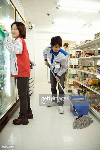 Store clerk cleaning