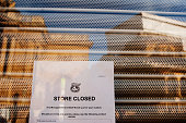 A 'Store Closed' notice stuck on the window of the shuttered 'phones4u' shop on Park Street in the popular Clifton area of Bristol following the...