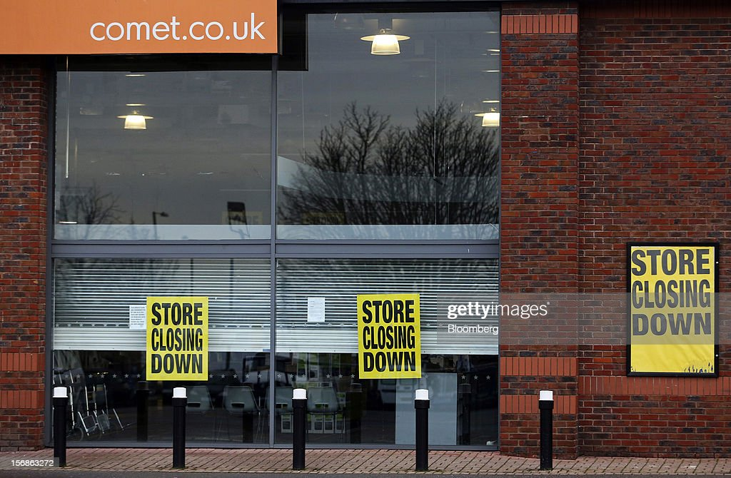 'Store Closing Down' signs are seen outside a Comet electronics store in Slough, U.K., on Friday, Nov. 23, 2012. Comet, a U.K. electronics chain, appointed Deloitte LLP as insolvency administrator, less than a year after being bought by private-equity firm OpCapita LLP. Photographer: Chris Ratcliffe/Bloomberg via Getty Images