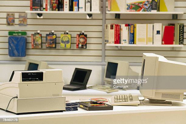 Store counter with cash register and computers