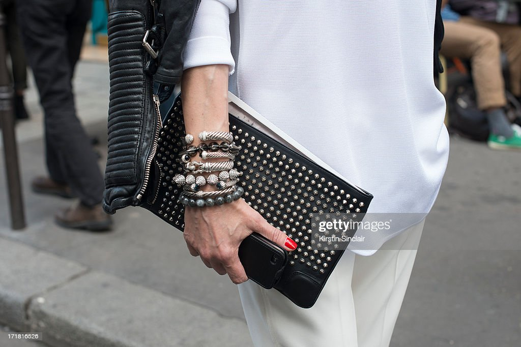 Store director for Kabuki Elina Halimi wears Alexander Wang trousers and top, Burberry Prosum jacket, Christian Louboutin clutch bag on day 3 of Paris Collections: Men on June 28, 2013 in Paris, France.