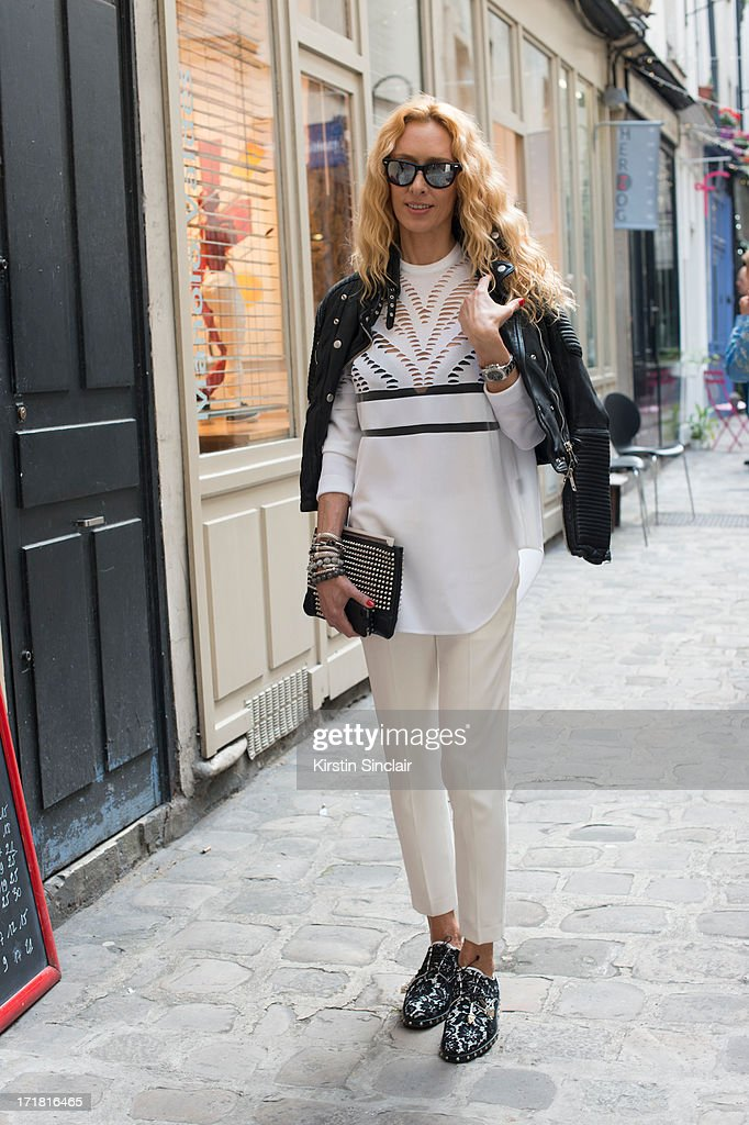 Store director for Kabuki Elina Halimi wears Givenchy shoes, Alexander Wang trousers and top, Burberry Prosum jacket, Christian Louboutin clutch bag and Ray Ban sunglasses on day 3 of Paris Collections: Men on June 28, 2013 in Paris, France.