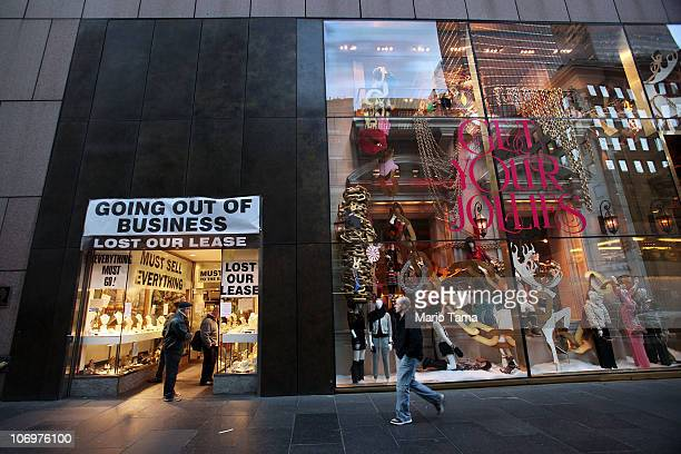 A store displaying a sign reading 'Going Out of Business' is seen next to the Juicy Couture holiday windows display on Fifth Avenue November 19 2010...