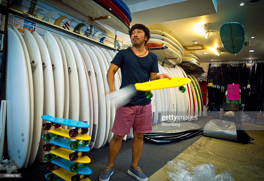 A store employee unpacks skateboards next to surfboards at a surf shop at Bondi Beach in Sydney, Australia, on Monday, Jan. 7, 2013. The Bureau of Statistics is scheduled to release retail sales data on Jan. 9. Photographer: Ian Waldie/Bloomberg via Getty Images