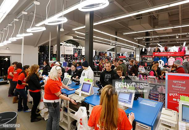 Store employees help customers at Old Navy in Freeport on Black Friday after the store opened it doors at midnight