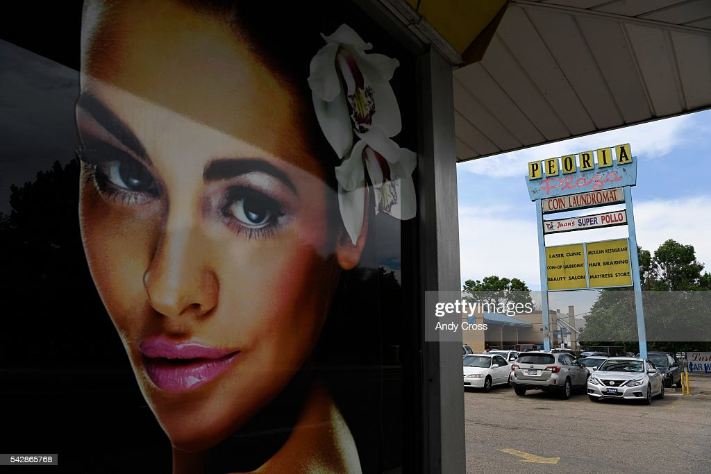 A store front poster for a laser clinic at the Peoria Plaza near Peoria and Colfax June 24, 2016.