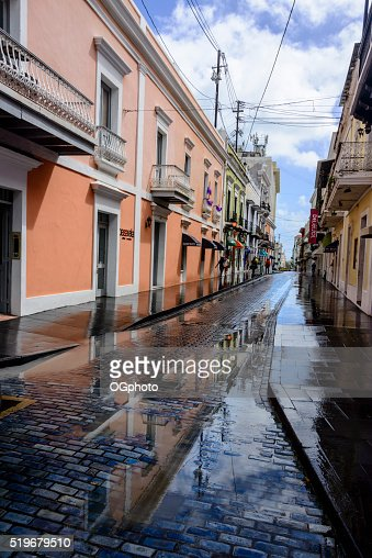 Store front reflections in streets of Old San Juan. : Stock Photo