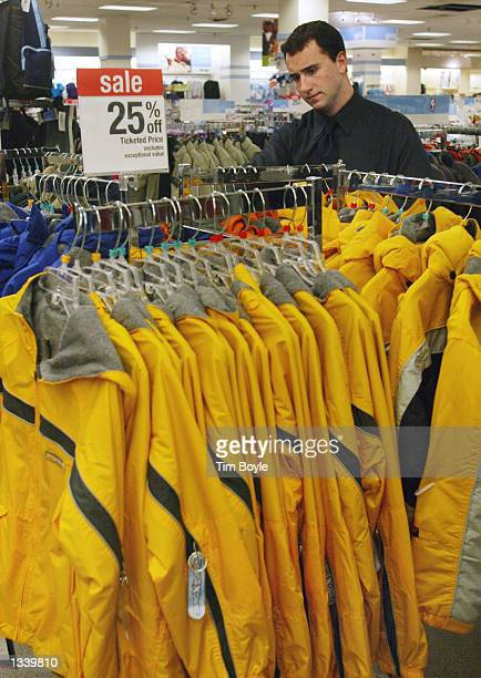 Store managerintraining Nick Giometti arranges fall jackets on sale August 16 2002 near the backtoschool department at a Sears store in the Golf Mill...