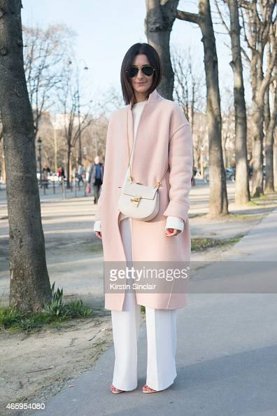 Store owner and fashion blogger Golestaneh wears a Celine coat Zara top and shoes Fall Winter Spring Summer trousers Chloe bag and Ray Ban sunglasses...