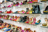 Women's colorful shoes on store shelf