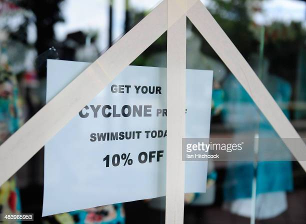 A storefront window is seen taped up for extra reinforcement before Tropical Cyclone Ita makes landfall later tonight on April 11 2014 in Port...