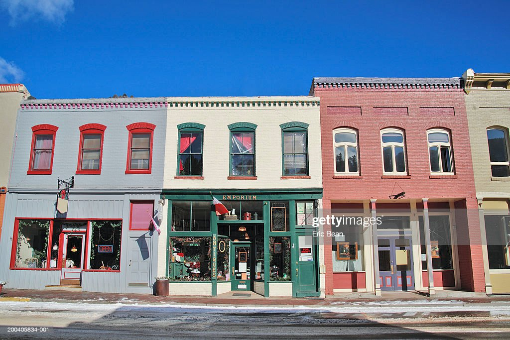 Storefronts along street, winter : Stock Photo