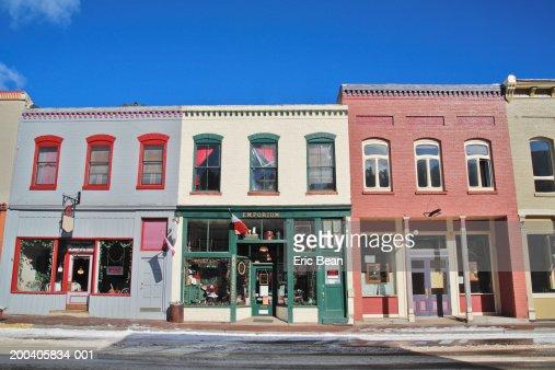 Storefronts along street, winter : Stock Photo