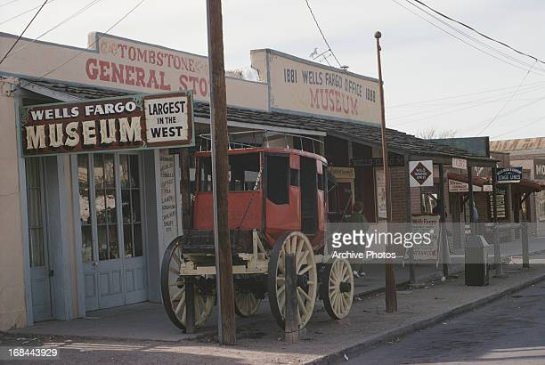 Storefronts including the Wells Fargo Museum and a carriage in the street in the Tombstone Historic District Tombstone Arizona circa 1965