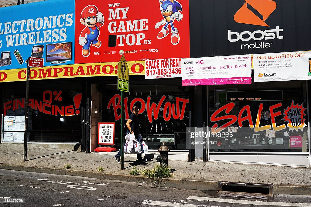 Stores advertise sales along a street in the South Bronx on September 19, 2013 in New York City. According to the 2010 U.S. Census Bureau report, over a quarter-million people in the South Bronx are living in poverty, making the 16th Congressional District the poorest in the nation. New Census Bureau numbers for all of New York City show that the poverty rate has risen to 21.2 percent in 2012, from 20.9 percent the year before. As New Yorkers prepare to vote for their next mayor following Michael Bloomberg, the Democratic candidate Bill de Blasio has focused on the theme that New York has transformed into a 'tale of two cities' under the Bloomberg administration.