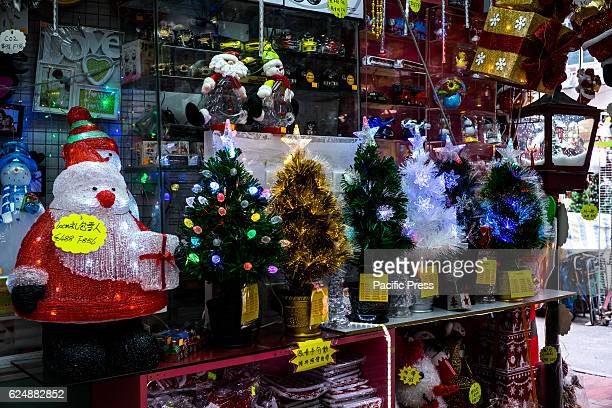Stores display related products before Christmas in Fuk Wing Street Before Christmas there are many people will come here to buy decorations