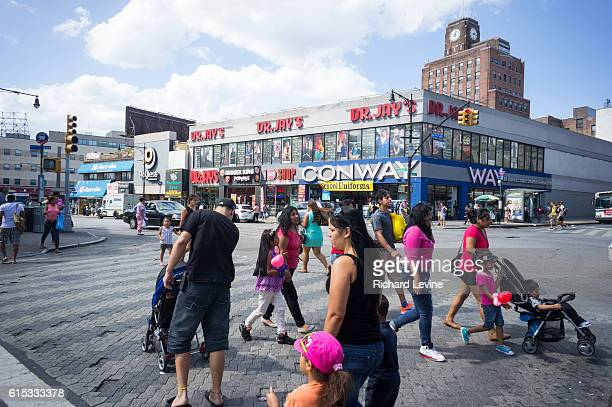 Stores in the Fordham Road shopping district in the Bronx in New York attract shoppers with their back to school sales on Sunday August 17 2014 A...