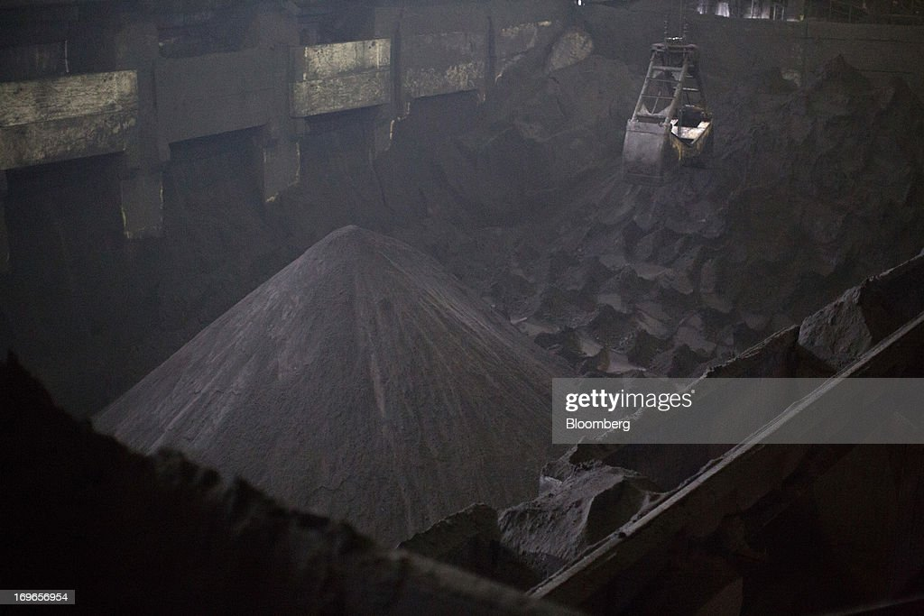 Stores of iron ore concentrate sit inside the Lebedinsky GOK (LGOK) iron ore mining and processing plant, operated by Metalloinvest Holding Co., in Gubkin, Russia, on Tuesday, May 28, 2013. Lebedinsky, Russia's third biggest iron ore mine, is owned 81 percent owned by Russian billionaire Alisher Usmanov, who also owns Mikhailovsky GOK, Russia's second-biggest iron ore mine, and Oskol Electrometallurgical Combine, a steel plant supplied by Lebedinsky. Photographer: Andrey Rudakov/Bloomberg via Getty Images