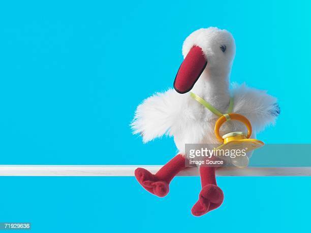 Stork toy with pacifier