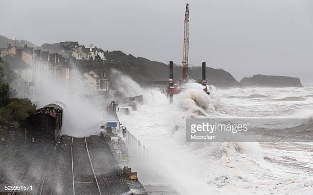 Storm at Dawlish with waves breaking over a goods train