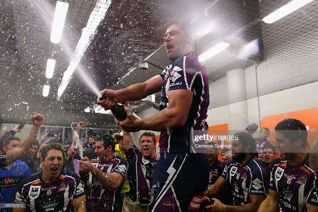 Storm captain <a gi-track='captionPersonalityLinkClicked' href=/galleries/search?phrase=Cameron+Smith+-+Rugby+League+Player&family=editorial&specificpeople=453295 ng-click='$event.stopPropagation()'>Cameron Smith</a> and team mates celebrate in their changeroom after winning the 2012 NRL Grand Final match between the Melbourne Storm and the Canterbury Bulldogs at ANZ Stadium on September 30, 2012 in Sydney, Australia.