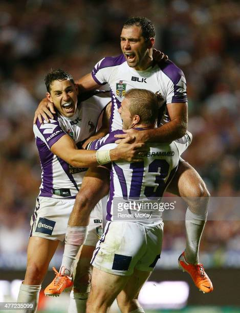Storm captain Cameron Smith celebrates his winning drop goal in golden point time with team mates Billy Slater and Ryan Hinchcliffe during the round...
