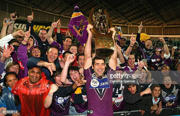 Storm captain Cameron Smith holds the NRL Premiership trophy aloft after winning the 2009 NRL Grand Final match between the Parramatta Eels and the...