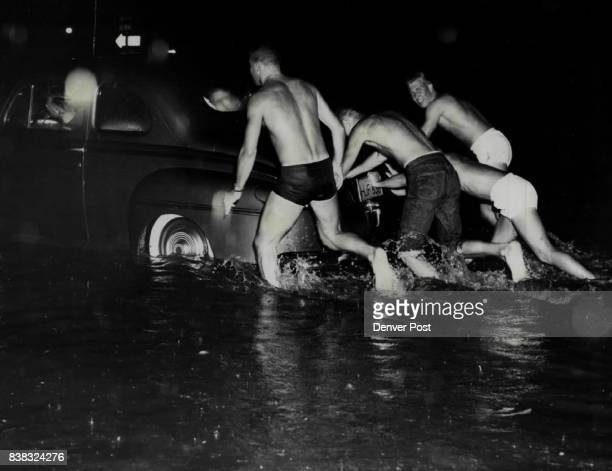 Storm Catches Lowry Airmen Ready For Action A3/C William O Walls and his buddies were all prepared for the three feet of water in which their car...