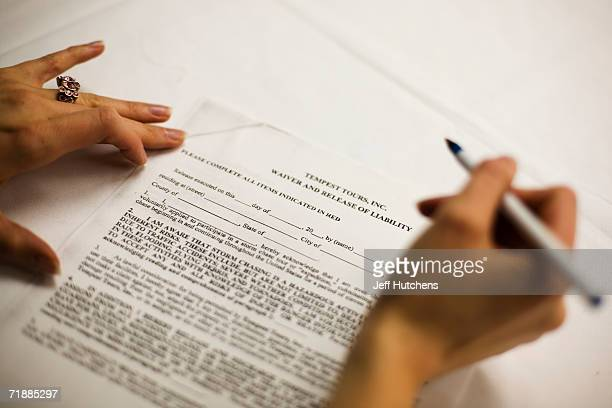 A storm chase tour participant signs an indemnity form after a briefing for a group of storm chasers prior to their storm chase tour of the Midwest...