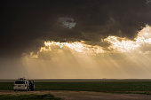 A storm chaser against the Great plains of the midwest. USA