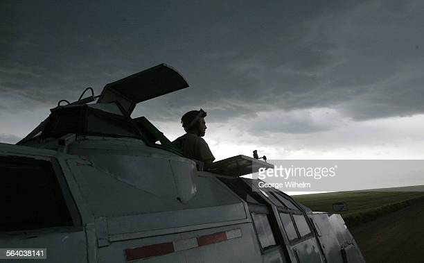 5/23/05 – Storm chaser and IMAX film maker Sean Casey surveyes the scene on a dirt road north of Akron Colorado in his Tornado Intercept Vehicle...